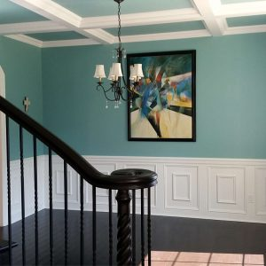 Coffered Ceiling And Curved Stair With Wainscote